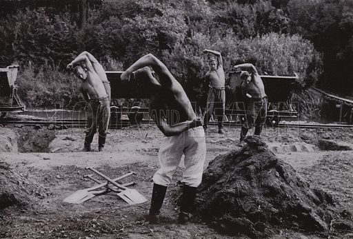 Nazi German workers of the Reich Labour Service (RAD) performing stretching exercises on a building site. Illustration from Arbeitsmanner des Fuhrers, by Gustav von Estorff (Zeitgeschichte Verlag, Wilhelm Andermann, Berlin, 1939).