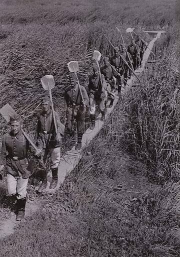 Nazi German workers of the Reich Labour Service (RAD) on a walkway through a bog. Illustration from Arbeitsmanner des Fuhrers, by Gustav von Estorff (Zeitgeschichte Verlag, Wilhelm Andermann, Berlin, 1939).