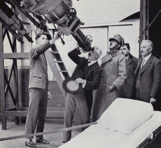 Sir Frank Dyson, when Astronomer Royal, demonstrating one of the great telescopes at Greenwich Observatory to ex-king Amanullah. Illustration for Master Minds of Modern Science by T C Bridges and H Hessell Tiltman (new edn, Harrap, 1934).  Photo credit: none.