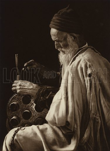 Tunis, Jewish Coppersmith. Illustration for Picturesque North Africa (Jarrolds, c 1925).  First published by Ernst Wasmuth, Berlin, 1925.  Gravure-printed. Photo credit: Lehnert and Landrock, Cairo.