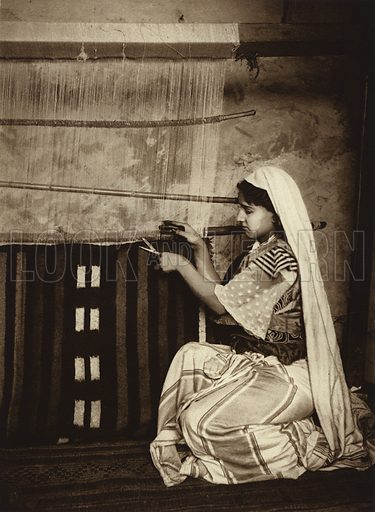 Tunis, Carpet-weaver. Illustration for Picturesque North Africa (Jarrolds, c 1925).  First published by Ernst Wasmuth, Berlin, 1925.  Gravure-printed. Photo credit: Lehnert and Landrock, Cairo.
