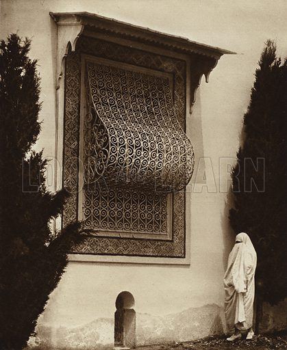 Sidi-Bou-Said, Harem window. Illustration for Picturesque North Africa (Jarrolds, c 1925).  First published by Ernst Wasmuth, Berlin, 1925.  Gravure-printed. Photo credit: Lehnert and Landrock, Cairo.