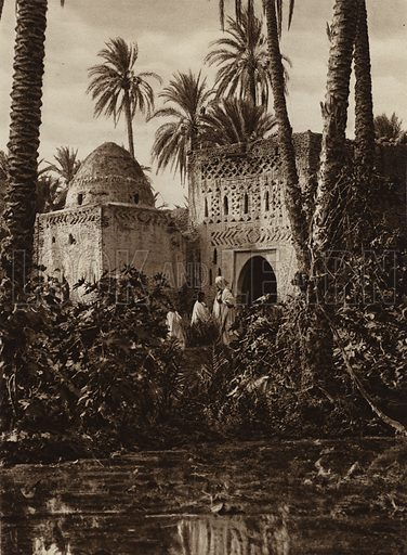 Tozeur Oasis, Clay buildings. Illustration for Picturesque North Africa (Jarrolds, c 1925).  First published by Ernst Wasmuth, Berlin, 1925.  Gravure-printed. Photo credit: Lehnert and Landrock, Cairo.