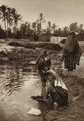 Gabes Oasis, Girl washing. Illustration for Picturesque North Africa (Jarrolds, c 1925).  First published by Ernst Wasmuth, Berlin, 1925.  Gravure-printed. Photo credit: Lehnert and Landrock, Cairo.