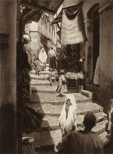 Algiers, In the Kasbah Quarter. Illustration for Picturesque North Africa (Jarrolds, c 1925).  First published by Ernst Wasmuth, Berlin, 1925.  Gravure-printed. Photo credit: Lehnert and Landrock, Cairo.