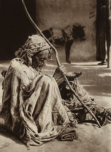 Algiers, Beggar. Illustration for Picturesque North Africa (Jarrolds, c 1925).  First published by Ernst Wasmuth, Berlin, 1925.  Gravure-printed. Photo credit: Lehnert and Landrock, Cairo.