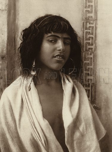 Algiers, Berber girl. Illustration for Picturesque North Africa (Jarrolds, c 1925).  First published by Ernst Wasmuth, Berlin, 1925.  Gravure-printed. Photo credit: Lehnert and Landrock, Cairo.