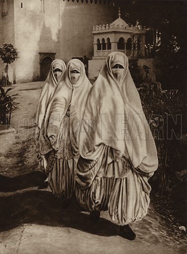 Algiers, Women at walk. Illustration for Picturesque North Africa (Jarrolds, c 1925).  First published by Ernst Wasmuth, Berlin, 1925.  Gravure-printed. Photo credit: Lehnert and Landrock, Cairo.