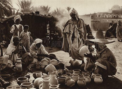 Touggourt Oasis, Pot Market. Illustration for Picturesque North Africa (Jarrolds, c 1925).  First published by Ernst Wasmuth, Berlin, 1925.  Gravure-printed. Photo credit: Lehnert and Landrock, Cairo.