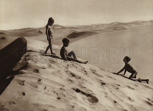 Sahara children. Illustration for Picturesque North Africa (Jarrolds, c 1925).  First published by Ernst Wasmuth, Berlin, 1925.  Gravure-printed. Photo credit: Lehnert and Landrock, Cairo.