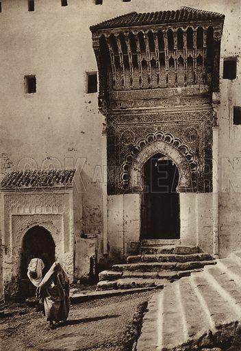 Sale, Rabat, Medersa Gate. Illustration for Picturesque North Africa (Jarrolds, c 1925).  First published by Ernst Wasmuth, Berlin, 1925.  Gravure-printed. Photo credit: Photo-Flandrin Casablanca.