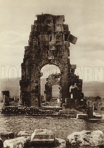 Volubills, Ruins of Hadrian's Temple. Illustration for Picturesque North Africa (Jarrolds, c 1925).  First published by Ernst Wasmuth, Berlin, 1925.  Gravure-printed. Photo credit: Photo-Flandrin Casablanca.