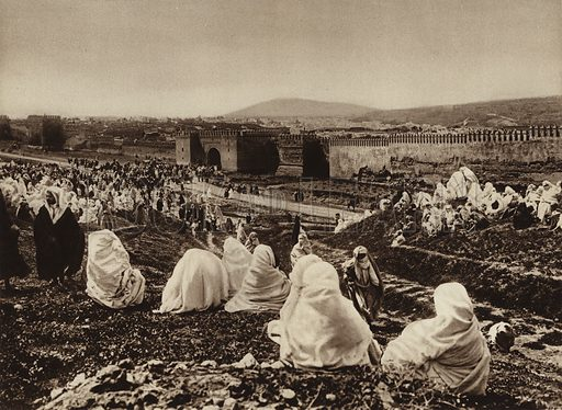 Fez, Feast before Bab Fetouh. Illustration for Picturesque North Africa (Jarrolds, c 1925).  First published by Ernst Wasmuth, Berlin, 1925.  Gravure-printed. Photo credit: Photo-Flandrin Casablanca.