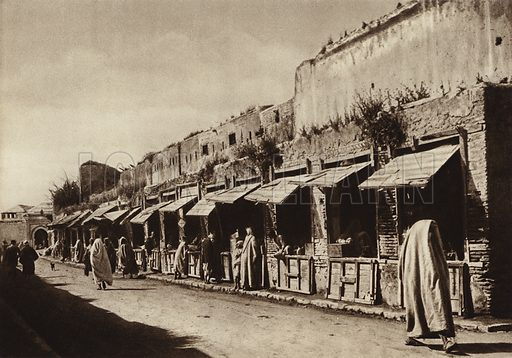 Meknes, The Jewellers' Lane. Illustration for Picturesque North Africa (Jarrolds, c 1925).  First published by Ernst Wasmuth, Berlin, 1925.  Gravure-printed. Photo credit: Photo-Flandrin Casablanca.