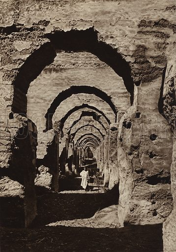 """Meknes, Ruins of the """"Haras"""". Illustration for Picturesque North Africa (Jarrolds, c 1925).  First published by Ernst Wasmuth, Berlin, 1925.  Gravure-printed. Photo credit: Photo-Flandrin Casablanca."""
