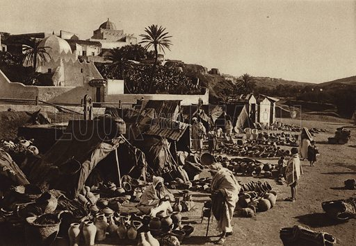 Saffi, Crockery market. Illustration for Picturesque North Africa (Jarrolds, c 1925).  First published by Ernst Wasmuth, Berlin, 1925.  Gravure-printed. Photo credit: Photo-Flandrin Casablanca.