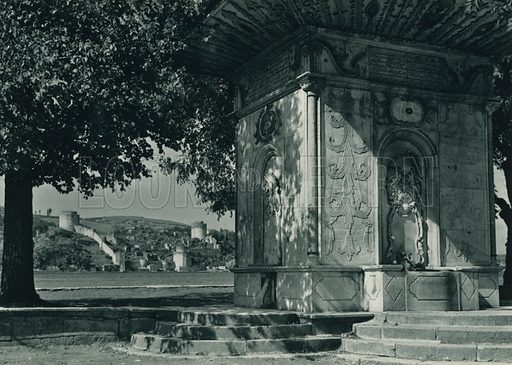 Rumelihisar kaleleri ve bir eski cesme, An old fountain and the Rumelihisar Towers on the Bosphorus. Illustration for Fotografla Turkiye [ie Turkey in Pictures] published by The General Direction of The Press, Ankara, c 1930.  Photographs provided by Orthmar Pferschy (1898-1984).  It is not clear whether or not all the photos are by Pferschy, or whether or not the copyright was acquired by the State.  Gravure printed.
