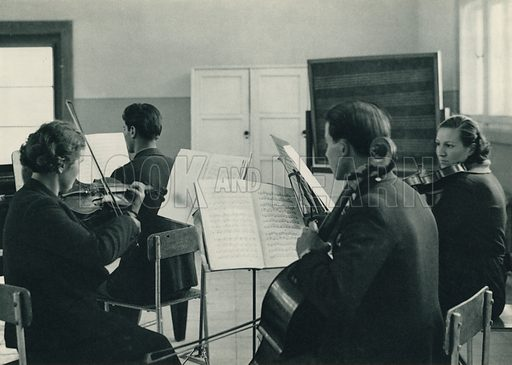 Musiki Muallim Mektebinde, A Lesson at the Normal School of music at Ankara. Illustration for Fotografla Turkiye [ie Turkey in Pictures] published by The General Direction of The Press, Ankara, c 1930.  Photographs provided by Orthmar Pferschy (1898-1984).  It is not clear whether or not all the photos are by Pferschy, or whether or not the copyright was acquired by the State.  Gravure printed.