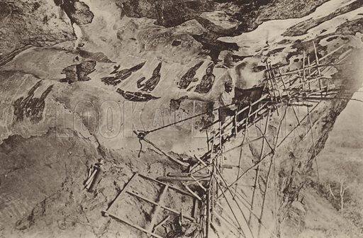 Copying the Frescoes of Sigiri. Illustration for The Ruined Cities of Ceylon by Henry W Cave, illustrated with photographs taken by the author in 1896, (3rd edn, Hutchinson, 1904).  Gravure printed.