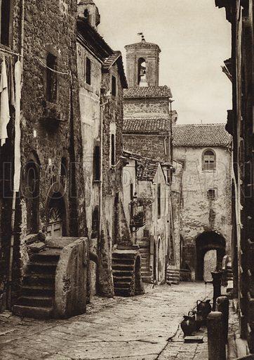 Montefiascone, Via Bizzio.  Illustration for Unbekanntes Italien [Unknown Italy] by Kurt Hielscher (F A Brockhaus, 1941). Gruvure printed.