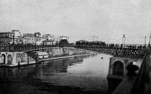 Taranto, Ponte girevole chiuso e citta vecchia. Illustration for Ricordo di Taranto (Giovanni Rimini, c 1900).  Only suitable for repro at small size.