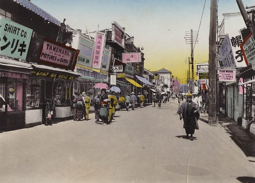 Matomachi Street, Kobe. Illustration for Selected Pictures of Mikado's Empire, Fine Souvenir for Visit to Japan, Coloured by Hand (np, c 1912).