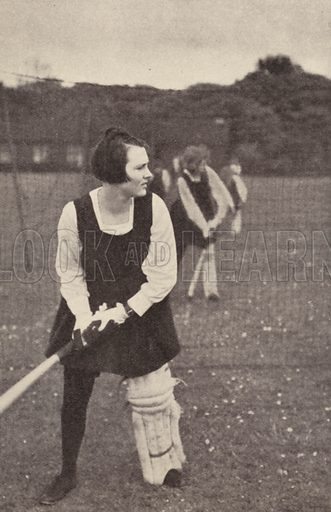 Girls practising batting in the cricket nets at Penrhos College, Colwyn Bay in North Wales