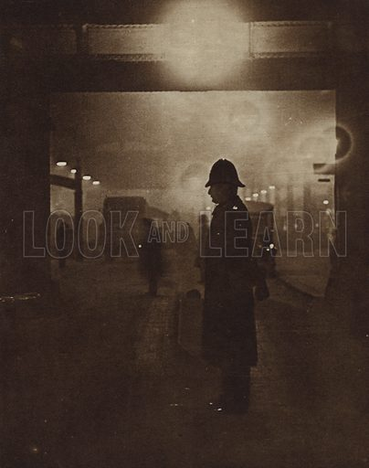 British policeman on a foggy street. Illustration from The Story of the World in Pictures (Odhams Press, London, 1934).
