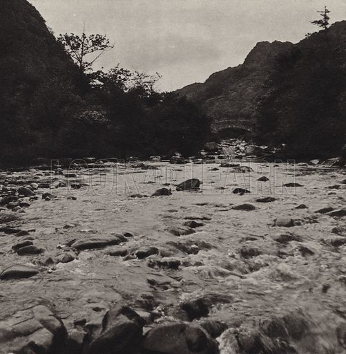 Seathwaite Stepping Stones. Illustration for The Charm of the English Lakes, A Book of Photographs by S W Colyer (Ward Lock, 1940).  Gravure printed.