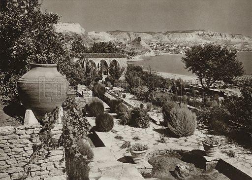 Balcic, In the Garden of the Castle. Illustration for Rumanien, Landschaft, Bauten, Volksleben, by Kurt Hielscher (F A Brockhaus, 1933).  Gravure printed.