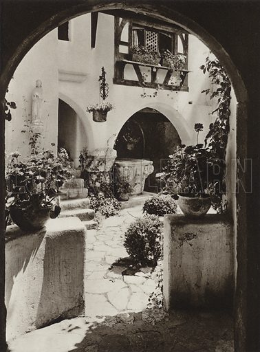 Bran, In the Courtyard of the Castle. Illustration for Rumanien, Landschaft, Bauten, Volksleben, by Kurt Hielscher (F A Brockhaus, 1933).  Gravure printed.