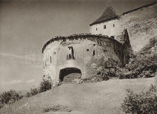 Rasnov, Entrance to the fortress. Illustration for Rumanien, Landschaft, Bauten, Volksleben, by Kurt Hielscher (F A Brockhaus, 1933).  Gravure printed.