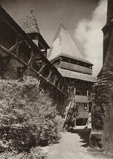 Homorod, Protecting wall of the fortified church. Illustration for Rumanien, Landschaft, Bauten, Volksleben, by Kurt Hielscher (F A Brockhaus, 1933).  Gravure printed.