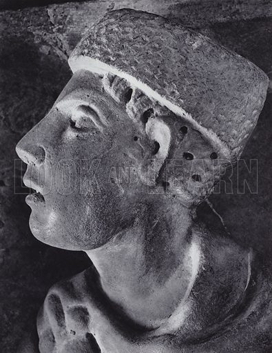 Head of a Boy, Detail of an Early Christian Sarcophagus-Relief, Time of Constantine the Great, 307-337 AD, Rome, Museo Lateranense Cristiano. Illustration for Roman Portraits edited by Ludwig Goldscheider (Phaidon Edition, Oxford University Press, New York, 1940). Gravure printed.