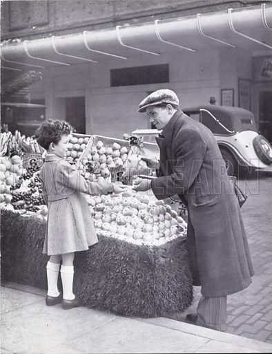 Boy buying fruit from a street vendor.  Illustration for My Little London Book prepared and photographed by Gilbert Cousland (Collins, 1936).