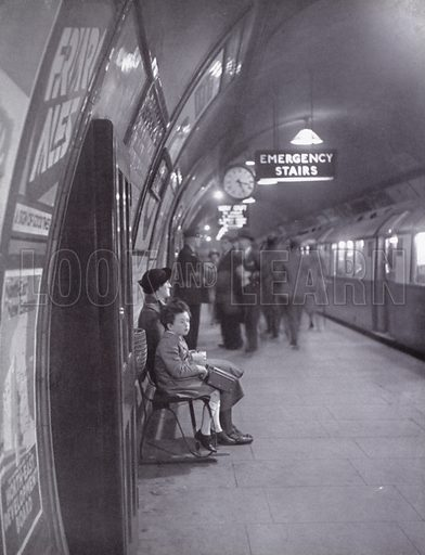 Waiting for a train on the London Underground.  Illustration for My Little London Book prepared and photographed by Gilbert Cousland (Collins, 1936).