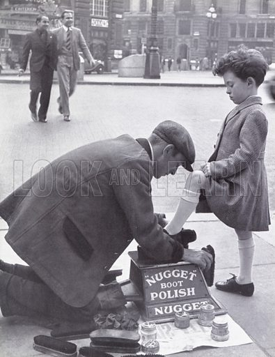 Boy having his shoes polished in Piccadilly Circus, London.  Illustration for My Little London Book prepared and photographed by Gilbert Cousland (Collins, 1936).