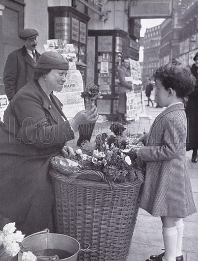Boy buying flowers off Piccadilly Circus, London.  Illustration for My Little London Book prepared and photographed by Gilbert Cousland (Collins, 1936).