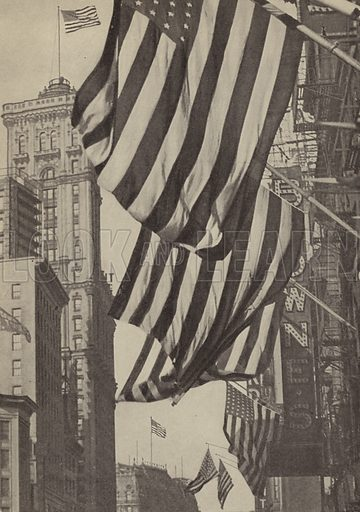 The Stars and Stripes flying on Broadway and 42nd Street, New York City, on Armistice Day, 11 November 1918. Illustration for Harper's Pictorial Library of the World War, c 1920.