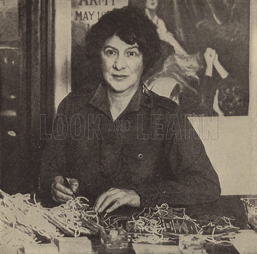 Evangeline Booth, Commander of the Salvation Army in the United States, signing tags upon which are printed the receipts for the famous Salvation Army doughnuts. Illustration for Harper's Pictorial Library of the World War, c 1920.
