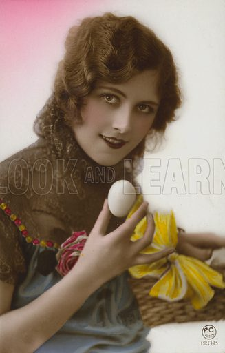 Girl holding an egg. Postcard, early 20th century.