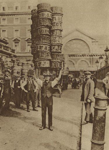 Porter lifting twenty-five vegetable baskets at Covent Garden Market