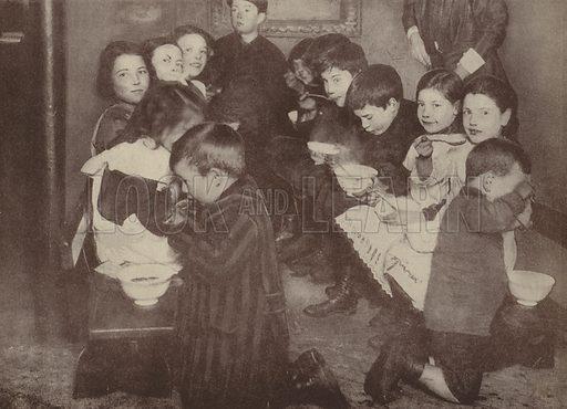 British children eating at a communal soup kitchen, World War I, 1917