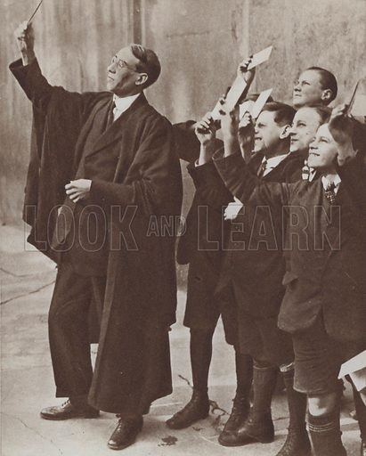 Schoolboys and their teacher watching a solar eclipse through smoked glass, 1921. Illustration from The Story of 25 Eventful Years in Pictures (Odhams Press Ltd, London, 1935).