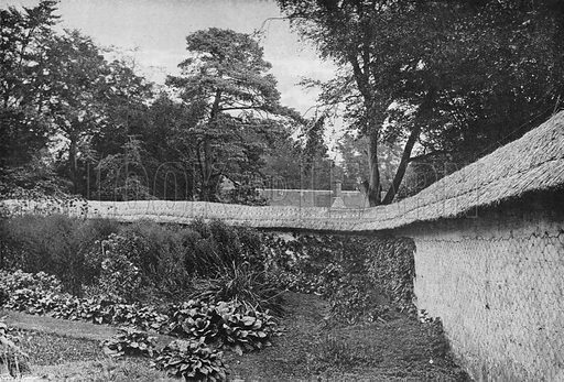 Garden Enclosed by Chalk Walls at Clouds. Photograph in Gardens Old and New Vol III (Country Life, c 1910).