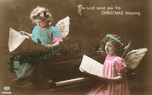 Christmas card featuring girls singing and dressed as angels.