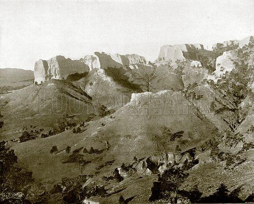 The Spanish Peaks, Nebraska. Illustration for Broader Britain (Werner, 1895).