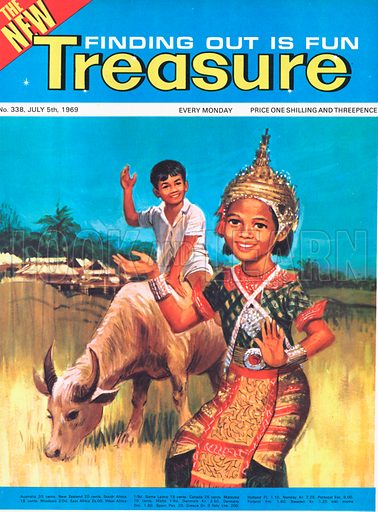 A Sri Lankan girl in traditional dress alongside a boy astride an ox.