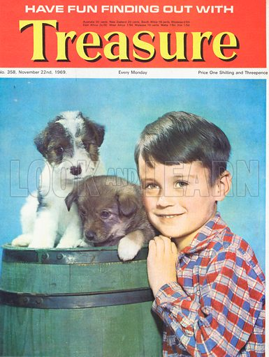 Photograph of a boy with two puppies in a barrel.