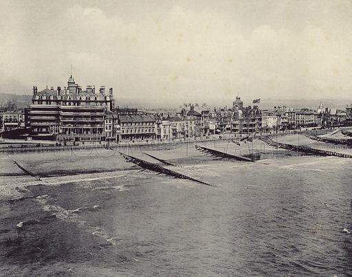 General view of The Marine and Royal Parades in Eastbourne, East Sussex, England, Great Britain, with the beach and buildings along the promenade beyond the waters of the coastline lapping the pebble beach.